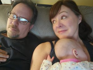 Photo w sleeping husband & our goddaughter.